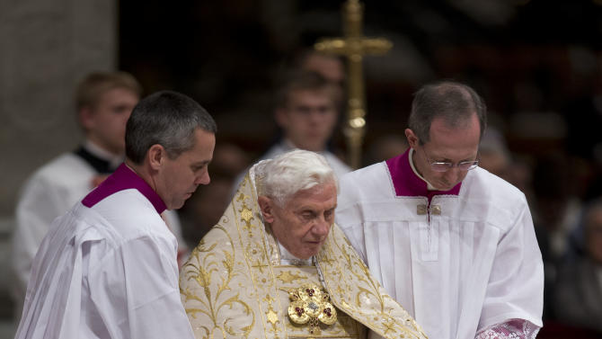 Pope Benedict XVI is helped walk down steps by his aides as he presides a New Year's Eve vespers service in St. Peter's Basilica at the Vatican, Monday, Dec. 31, 2012. Pope Benedict XVI has marked the end of a difficult year by saying that despite all the death and injustice in the world, goodness prevails. Benedict celebrated New Year's Eve with a vespers service in St. Peter's Basilica to give thanks for 2012 and look ahead to 2013. He looked tired during the service and used a cane afterward, an indication that the busy Christmas season may be taking a toll on the 85-year-old Benedict. (AP Photo/Andrew Medichini)
