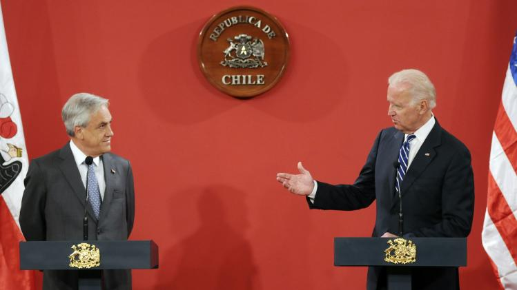 U.S. Vice President Biden speaks with Chile's President Pinera during a news conference in Santiago