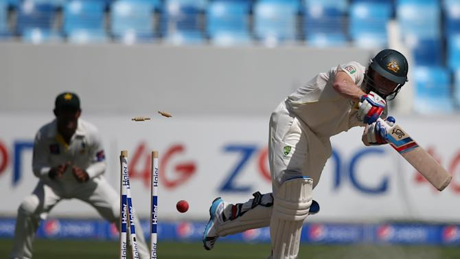 Chris Rogers of Australia is bowled by Imran Khan of Pakistan during day five of the First Test between Pakistan and Australia at the Dubai International Stadium in the United Arab Emirates, Sunday, Oct. 26, 2014. (AP Photo/Kamran Jebreili)