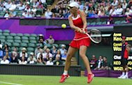 Empty seats can be seen behind Denmark&#39;s Caroline Wozniacki during her match against Briton Anne Keothavong during at the Wimbledon tennis club during the London Olympics on July 28. The organisers of the London Olympics faced a growing storm Sunday over blocks of empty seats at several venues, while British police were reportedly probing an alleged black-market scandal