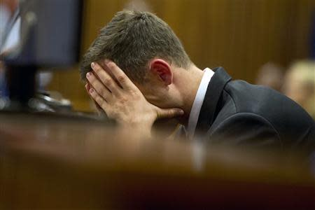 Oscar Pistorius reacts during his trial at the high court in Pretoria