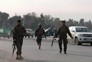 Afghan National Army soldiers block a road at the site of a suicide attack in the city of Jalalabad in Nangarhar province in February 2012. US President Barack Obama and other Western leaders have vowed to support Afghanistan through military training and other assistance after the pullout of combat troops
