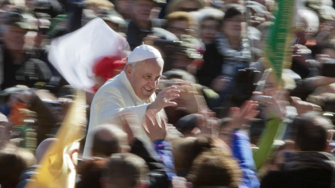 """Pope Francis greets the crowd as he arrives for his weekly general audience in St. Peter's Square at the Vatican, Wednesday, March 5, 2014. The pontiff says he finds the hype that is increasingly surrounding him """"offensive."""" In an interview with Italian daily Corriere della Sera, Francis said he doesn't appreciate the myth-making that has seen him depicted as a """"Superpope"""" who sneaks out at night to feed the poor. On Wednesday, a new Italian weekly hit newsstands — a gossip magazine devoted entirely to the pope. Francis said: """"The pope is a man who laughs, cries, sleeps calmly and has friends like everyone else. A normal person."""" (AP Photo/Alessandra Tarantino)"""