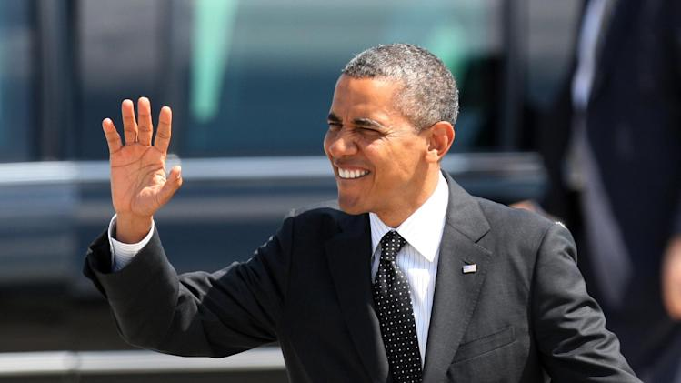 President Barack Obama waves upon his arrival, Tuesday, July 24, 2012