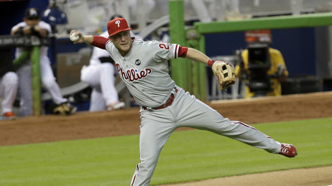 Philadelphia Phillies third baseman Cody Asche (25) prepares to throw to first base after fielding a ground ball during a baseball game against the Miami Marlins, Friday, May 1, 2015, in Miami. (AP Photo/Alan Diaz)