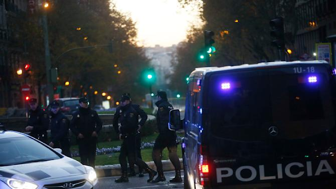 Spanish riot police stand guard outside the headquarters of Spain's ruling People's Party (PP) in Madrid
