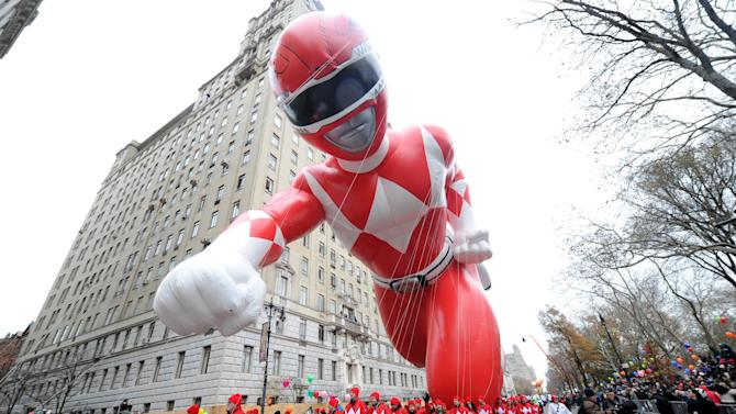 IMAGE DISTRIBUTED FOR POWER RANGERS - The Red Mighty Morphin Power Ranger makes his legendary debut at the 88th annual Macy's Thanksgiving Day Parade, Thursday, Nov. 27, 2014, in New York. (Photo by Diane Bondareff/Invision for Power Rangers/AP Images)