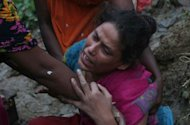 <p>A Bangladeshi relative of landslide victims mourns in Chittagong. More than 55 people have been killed in landslides in southeast Bangladesh after three days of rains that triggered flash floods and severed transport links.</p>
