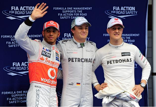 Mercedes-AMG driver Nico Rosberg of Germany (C), McLaren-Mercedes driver Lewis Hamilton of Britain (L) and Mercedes-AMG driver Michael Schumacher of Germany (R) celebrate after the qualifying session