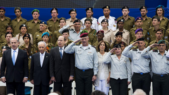 Israeli Prime Minister Benjamin Netanyahu, left, Israeli President Shimon Peres, second left, and Israeli military's chief of staff Lt. Gen. Benny Gantz, fourth left, mark Israel's Independence Day celebration at the President's residence in Jerusalem, Israel, Tuesday, April 16, 2013. Israel is celebrating 65 years of independence with barbeques, air force flyovers, and a bible quiz. (AP Photo/Llia Yefimovich, Pool)