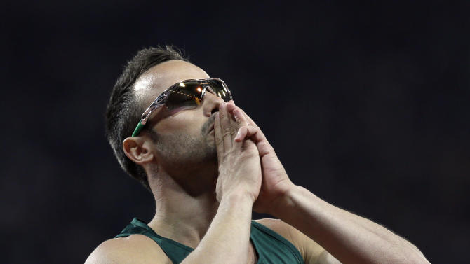 South Africa's Oscar Pistorius celebrates winning gold in the men's 400-meter T44 final at the 2012 Paralympics, Saturday, Sept. 8, 2012, in London. (AP Photo/Kirsty Wigglesworth)