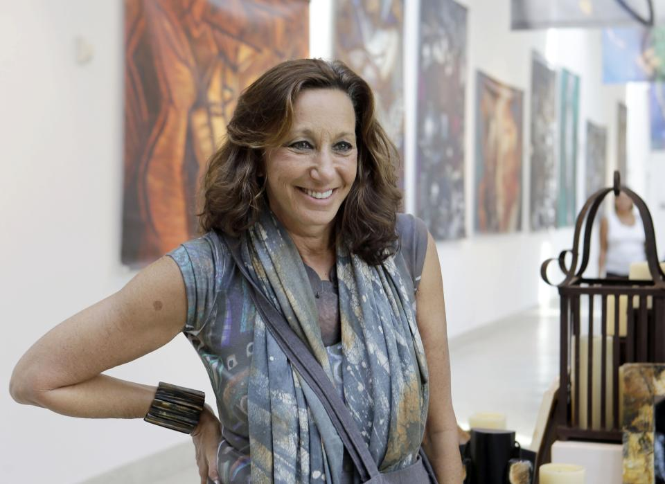 Fashion designer Donna Karan poses for photographers during her visit to Little Haiti at the Discover Haiti Exhibition in Miami, Friday, May 17, 2013. Karan is among the designers and celebrities who have advocated for Haitian artisans since a catastrophic earthquake shook the Caribbean country in 2010. (AP Photo/Alan Diaz)
