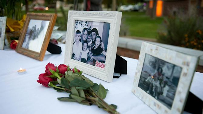 """FILE - In this Oct. 2, 2014 file photo, flowers and photos are on display during a vigil for the Strack family at Pioneer Park in Provo, Utah. Police say five members of the Utah family found dead last fall died from methadone and other drugs, and interviews with people who knew them revealed the parents worried about a """"pending apocalypse."""" Springville Police Chief J. Scott Finlayson said Tuesday, Jan. 27, 2015, authorities have concluded their investigation into the September deaths of Benjamin and Kristi Strack and three of their children, ages 11, 12 and 14.  (AP Photo/The Daily Herald, Grant Hindsley, File) MANDATORY CREDIT"""