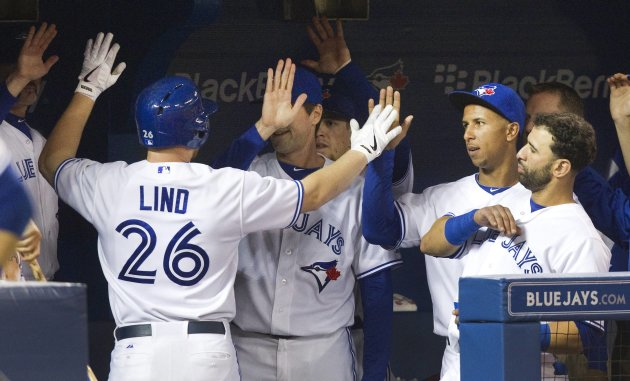 Toronto Blue Jays' Lind is greeted in the dugout after hitting a solo home run against the Baltimore Orioles during their MLB American League baseball game in Toronto