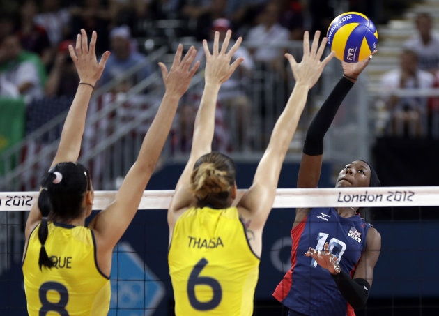 USA&#39;s Destinee Hooker (19, right) prepares to smash the ball past Brazil&#39;s Jaqueline Carvalho (8) and Thaisa Menezes (6) during a women&#39;s volleyball gold medal match at the 2012 Summer Olympics Saturday, Aug. 11, 2012, in London. (AP Photo/Chris O&#39;Meara)