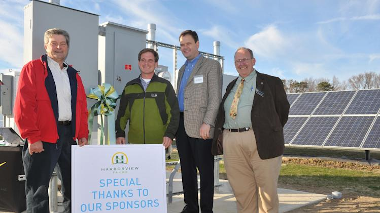 "Left to right, Earl ""Buddy"" Hance, Maryland Secretary of Agriculture; Trey Hill, Partner, Harborview Farms; John Chrosniak, Director, North America DuPont Crop Protection and Richard Sossi, liaison for Maryland Congressman Andy Harris prepare to activate a new 200 kW solar array at the Sustainable Agriculture Celebration at Harborview Farms on Thursday, December 6, 2012 in Rock Hall, MD. Harborview Farms is one of the largest and most sustainably driven farming operations in Maryland. (Larry French/AP Images for DuPont)"