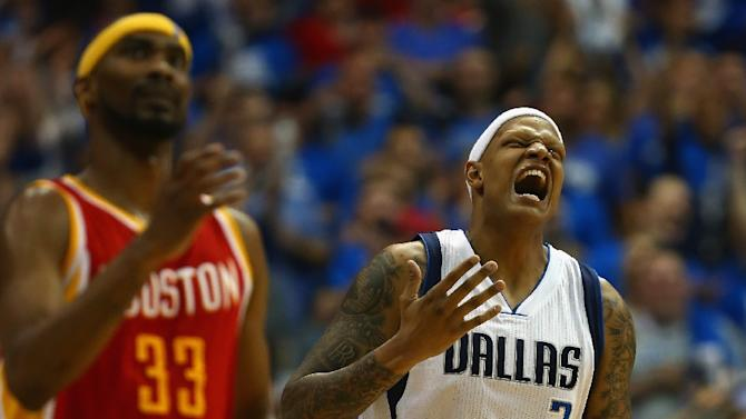 Charlie Villanueva (R) of the Dallas Mavericks reacts after making a 3-pointer against the Houston Rockets, during Game 4 of the Western Conference quarter-finals of the NBA playoffs, at American Airlines Center in Dallas, Texas, on April 26, 2015