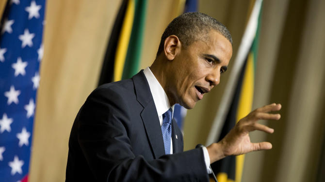 U.S. President Barack Obama gestures during a news conference with South African President Jacob Zuma, not pictured, at the Union Building on Saturday, June 29, 2013, in Pretoria, South Africa. The president is in South Africa, embarking on the second leg of his three-country African journey. The visit comes at a poignant time, with former South African president and anti-apartheid hero Nelson Mandela ailing in a Johannesburg hospital. (AP Photo/Evan Vucci)