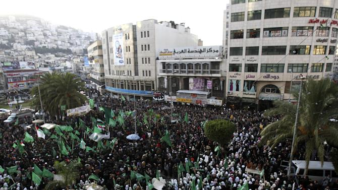 Palestinian supporters of Hamas gather during a rally to celebrate the 25th anniversary of the Hamas militant group, in the West Bank city of Nablus, Thursday, Dec. 13, 2012. Hamas supporters rallied in the first display of force by the Islamic militant group in the West Bank since it overran Gaza from the Western-backed party of Palestinian President Mahmoud Abbas in 2007. (AP Photo/Nasser Ishtayeh)