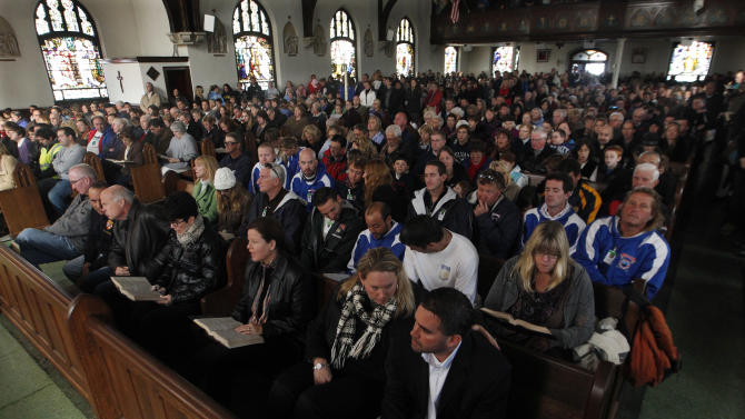Worshippers listen to a service by Diocese of Trenton American Roman Catholic Bishop David M. O'Connell at the Church of Saint Rose in Belmar, N.J., Sunday, Nov. 4, 2012. Many in the region who went through Monday's storm surge by Superstorm Sandy are still without power. (AP Photo/Mel Evans)