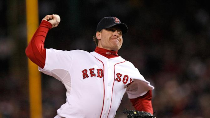 FILE-In this Oct. 25, 2007, file photo, Boston Red Sox's Curt Schilling pitches against the Colorado Rockies in Game 2 of the baseball World Series at Fenway Park in Boston. Schilling has dabbled in politics, World War II history and raised millions for Lou Gehrig's disease, but it's a gamble on his video game company 38 studios that is in danger of failing and possibly leaving Rhode Island taxpayers with the tab on a $75 million loan guarantee that lured the firm from Massachusetts in 2010. (AP Photo/Kathy Willens, File)