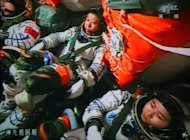 Chinese astronauts Liu Wang (centre), Jing Haipeng (left) and Liu Yang inside the Shenzhou-9 spacecraft as it prepares to link with the Tiangong-1 module. A Chinese spacecraft has successfully completed the country's first manual docking in orbit, a milestone in an ambitious programme to build a space station by the end of the decade