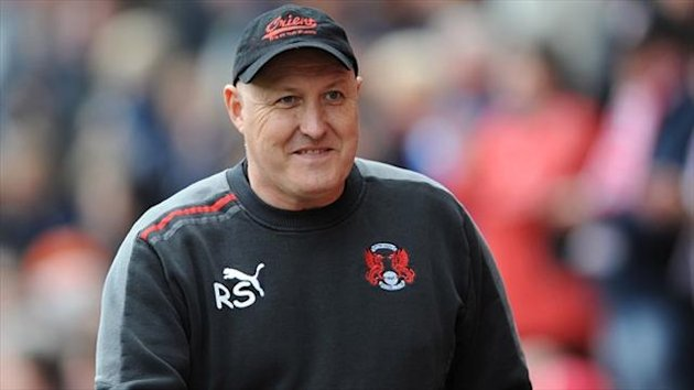 Russell Slade and his backroom staff have signed contract extensions