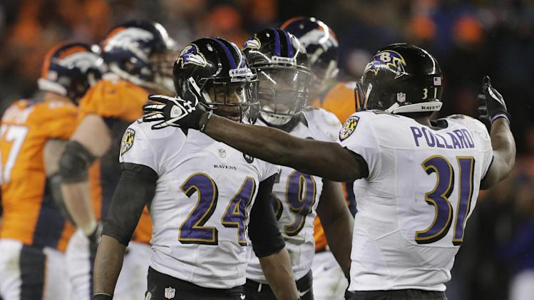 Baltimore Ravens cornerback Corey Graham (24) is congratulated by Baltimore Ravens strong safety Bernard Pollard (31) after intercepting a pass against the Denver Broncos in overtime of an AFC divisional playoff NFL football game, Saturday, Jan. 12, 2013, in Denver. The Ravens won 38-35. (AP Photo/Charlie Riedel)