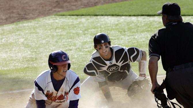Clemson's Steve Wilkerson is safe at home plate as South Carolina catcher Dante Rosenberg reacts to the call by the umpire during the sixth inning of an NCAA college baseball tournament regional game in Columbia, S.C., Sunday, June 3, 2012. South Carolina won 4-3. (AP Photo/Mary Ann Chastain)
