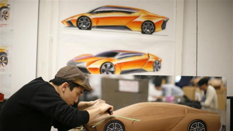 Junghan Kim from South Korea works on a clay design for a 2023 Lamborghini during a Transportation Design class in Pasadena