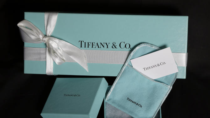 This Nov. 27, 2012, photo shows Tiffany & Co. gift boxes displayed in Boston. Tiffany & Co. said Thursday, Nov. 29, 2012, third-quarter net income fell 30 percent, stung by a higher-than-expected tax rate, ongoing economic weakness and high precious metal and diamond costs. (AP Photo/Elise Amendola)