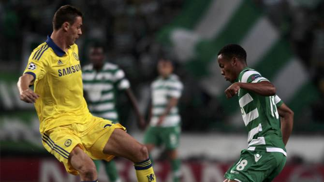 Chelsea's Nemanja Matic and Sporting Lisbon's Andre Carrillo fight for the ball during their Champions League Group G soccer match at the Estadio Jose Alvade in Lisbon,