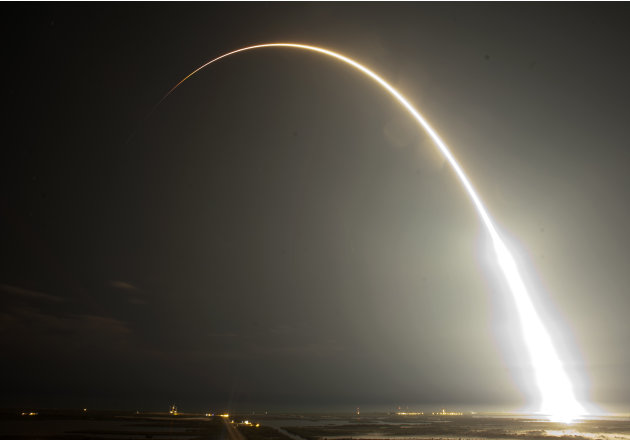 The Falcon 9 SpaceX rocket is seen during a time exsposure as it lifts off from space launch complex 40 at the Cape Canaveral Air Force Station in Cape Canaveral, Fla., early Tuesday, May 22, 2012. Th