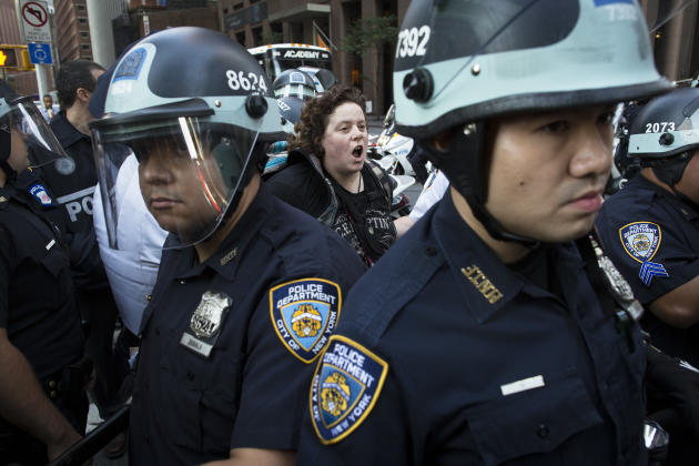 A photographer is arrested during an Occupy Wall Street march as police stand guard, Monday, Sept. 17, 2012, in New York. A handful of Occupy Wall Street protestors have been arrested during a march t