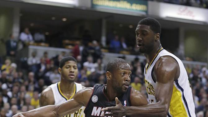 Miami Heat's Dwyane Wade (3) works against Indiana Pacers' Roy Hibbert, right, during the first half of an NBA basketball game Tuesday, Jan. 8, 2013, in Indianapolis. (AP Photo/Darron Cummings)
