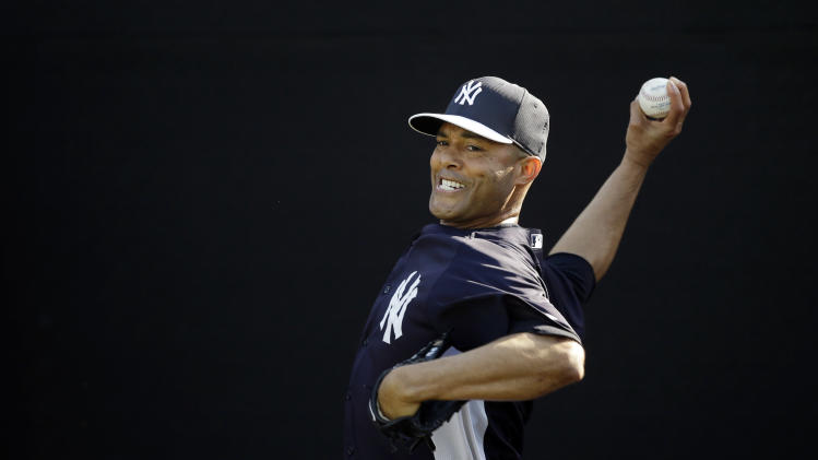 New York Yankees' Mariano Rivera pitches during a workout at baseball spring training, Saturday, Feb. 16, 2013, in Tampa, Fla. (AP Photo/Matt Slocum)