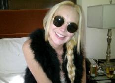 Lindsay Lohan show off her new smile on October 30, 2011 -- WhoSay