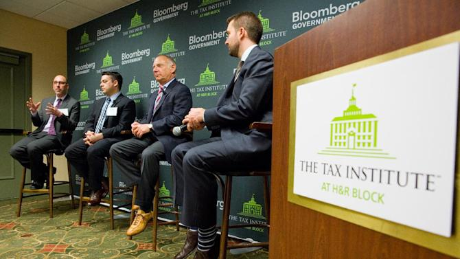 IMAGE DISTRIBUTED FOR THE TAX INSTITUTE AT H&R BLOCK - Larry Levitt, left, Senior Vice President for Special Initiatives for the Kaiser Family Foundation, speaks during a panel discussion on the tax implications of health care reform on Thursday, March 21, 2013 in Sacramento, Calif. The event is part of a multi-city engagement tour hosted by The Tax Institute at H&R Block and Bloomberg Government examining the effects of the Affordable Care Act on consumers, small businesses and the uninsured. (John Decker / AP Images for The Tax Institute at H&R Block)