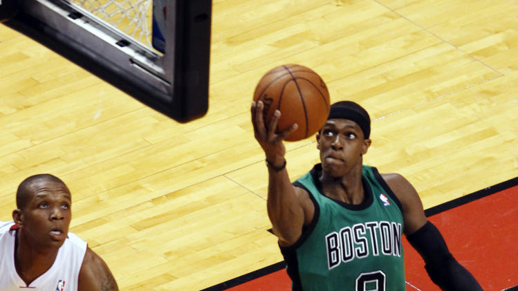 Boston Celtics' Rajon Rondo (9) shoots over Miami Heat's James Jones (22) during the first half of Game 2 in their NBA basketball Eastern Conference finals playoffs series, Wednesday, May 30, 2012, in Miami. (AP Photo/Wilfredo Lee)