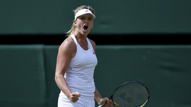 Coco Vandeweghe of the U.S.A. reacts after breaking serve during her match against Maria Sharapova of Russia at the Wimbledon Tennis Championships in London