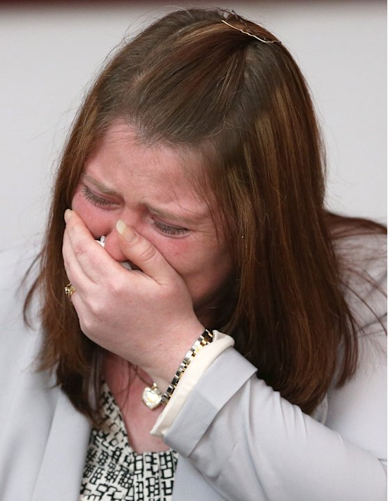 Rebecca Rigby the wife of murdered soldier Lee Rigby, cries at a news conference held at the Regimental HQ of the Royal Regiment of Fusiliers, in Bury