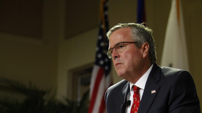 Former Florida Gov. Jeb Bush attends an event at the Metropolitan University in San Juan, Puerto Rico, Tuesday, April 28, 2015. The former Florida governor delivered a speech on economic opportunities partly in Spanish on Tuesday, and his audience responded with hearty applause. Bush is fluent in the language, and often uses it in Florida, but it's rarely heard in Republican presidential campaign politics. (AP Photo/Ricardo Arduengo)