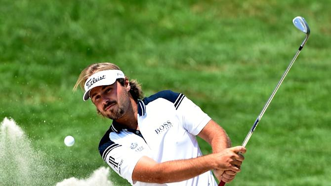 France's Victor Dubuisson plays a bunker shot during the second round of the 2015 French Golf Open on July 3, 2015 at Le Golf National in Guyancourt, near Paris