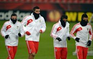 Bayer Leverkusen's players warm up during a training session on February 13, 2013, on the eve of their Europa League game home to Benfica. The competition is at the round-of-32 stage