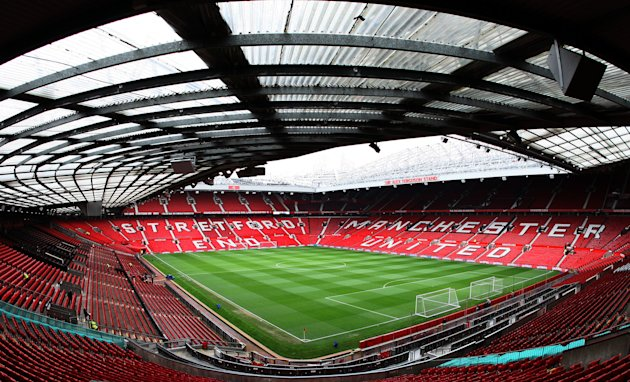 FILE - In this March 11, 2012, file photo, Old Trafford stadium appears empty ahead of an English Premier League soccer match between Manchester United and West Bromwich Albion in Manchester, England. Manchester United filed a registration statement, Tuesday, July 3, with the U.S. government to hold an initial public offering of stock and become a listed company on the New York Stock Exchange. (AP Photo/Scott Heppell, File)