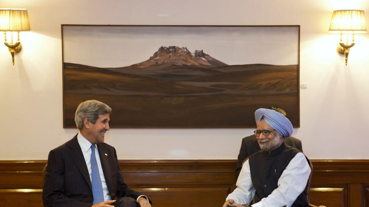 U.S. Secretary of State John Kerry, left, meets with Indian Prime Minister Manmohan Singh at the prime minister's residence in New Delhi, India on Monday, June 24, 2013, during Kerry's first visit to India as secretary. (AP Photo/Jacquelyn Martin, Pool)