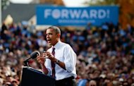 US President Barack Obama speaks at a campaign rally in Nashua, New Hampshire. The approach of what could be the most devastating storm in decades threw a surprise into the US presidential contest as Obama and Mitt Romney hunted for votes -- and took swipes at each other -- amid fears of chaos ahead of the November 6 election