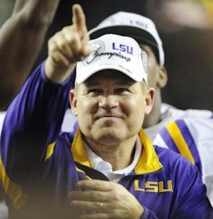 FILE- In this Dec. 3, 2011, file photo, LSU head coach Les Miles reacts after their 42-10 win over Georgia in the Southeastern Conference championship NCAA college football game in Atlanta. Miles was selected as The Associated Press college football coach of the year on Tuesday, Dec. 20, 2011. (AP Photo/Stephen Morton, File)