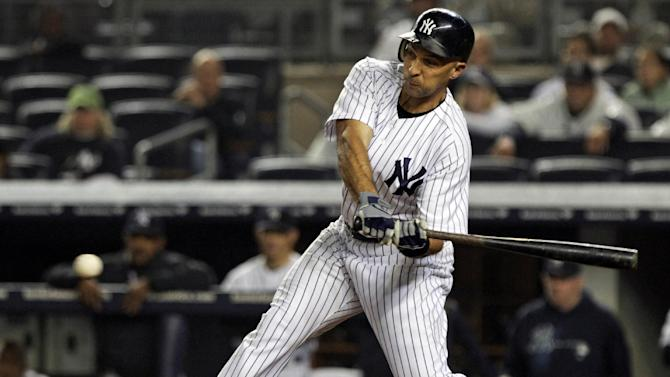 New York Yankees' Raul Ibanez hits an RBI single during the 12th inning to win a baseball game against the Boston Red Sox, Tuesday, Oct. 2, 2012, in New York. The Yankees won 4-3. (AP Photo/Frank Franklin II)