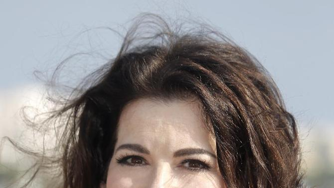 "In this Oct. 9, 2012 file photo, English food writer, journalist and broadcaster, Nigella Lawson poses during the 28th MIPCOM (International Film and Programme Market for Tv, Video,Cable and Satellite) in Cannes, southeastern France. With a new cookbook, ""Nigellissima,"" coming on the heels of a new celebrity-rich reality food television show on ABC, the English food star seems intent on leaving a larger mark on the American culinary scene. (AP Photo/Lionel Cironneau, File )"